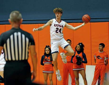 UTSA center Jacob Germany attempts to save the ball from going out of bounds in second half action on Saturday, December 29, 2019. Final score is UTSA 99-Our Lady of the Lake 64
