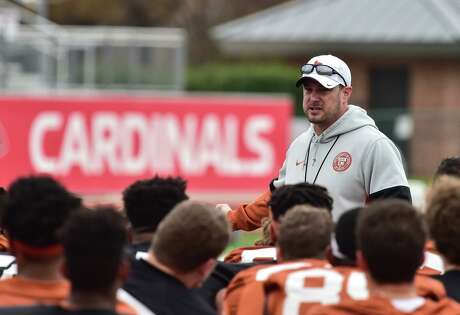 Texas coach Tom Herman, talking to his players during practice for the 2019 Valero Alamo Bowl, is adjusting to his new reality when it comes to offseason football.