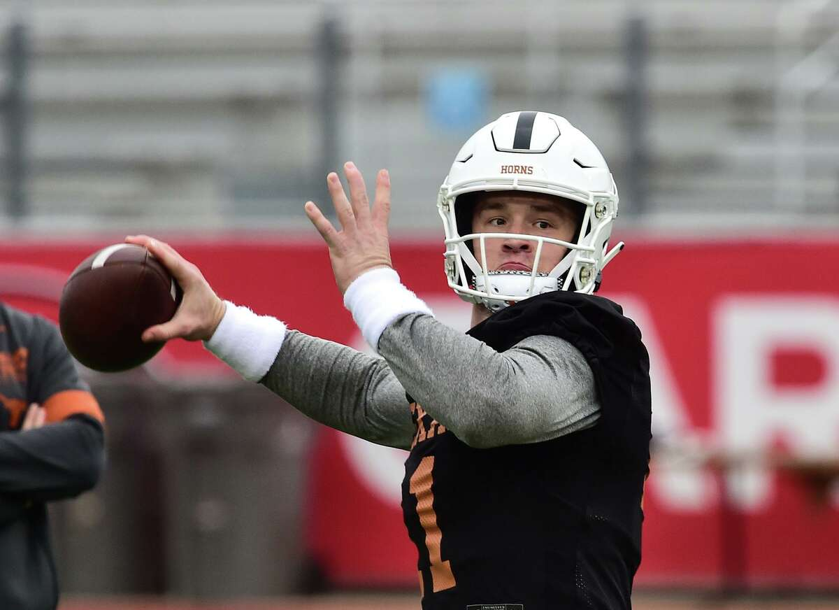Texas Longhorn quarterback Sam Ehlinger goes through a play during practice at the University of the Incarnate Word's Benson Stadium Satrday morning in preparation for the Longhorn's New Years Eve Alamo Bowl game versus Utah.