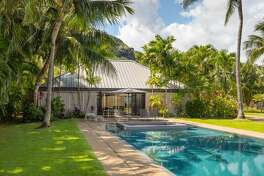 The home of prominent business woman and philanthropist Elizabeth Rice Grossman, this stunning Hawaiian beach estate and art gallery could be yours for $21M