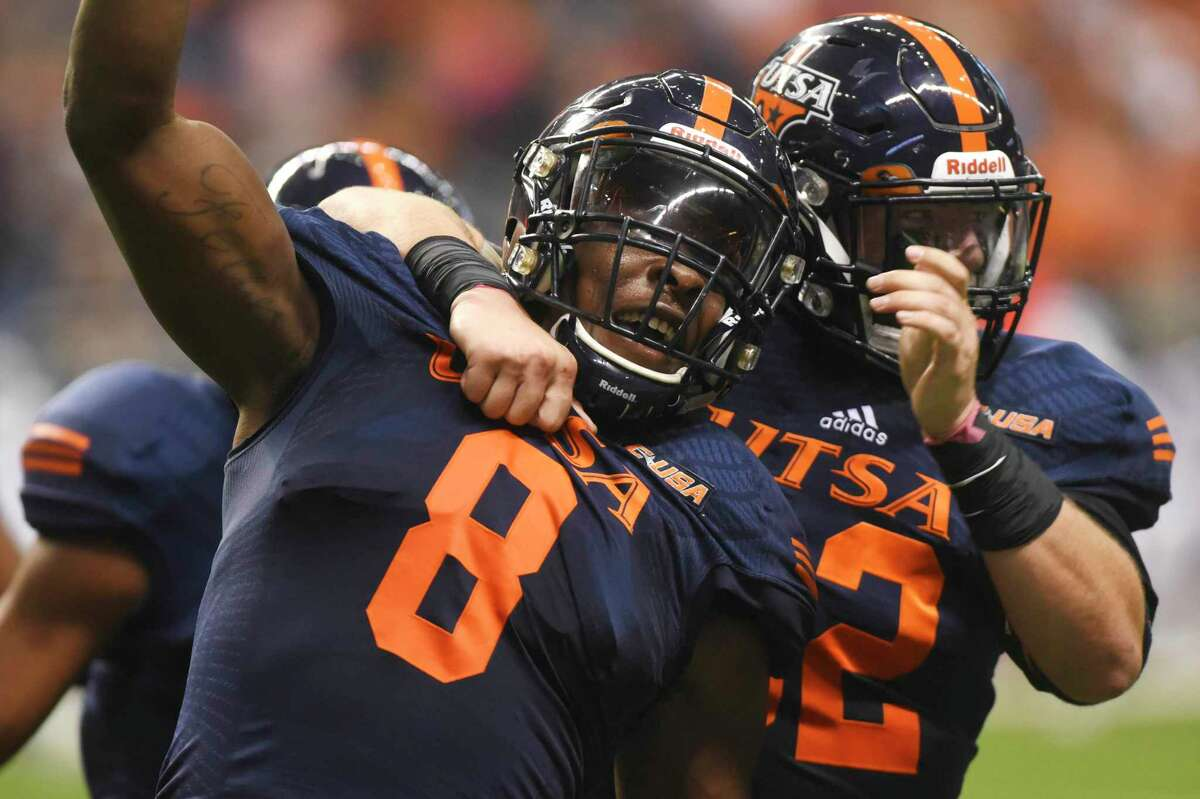 UTSA defensive back Michael Egwuagu celebrates with teammates after intercepting a first-half pass against Louisiana Tech in the Alamodome on Saturday, Oct. 10, 2015.