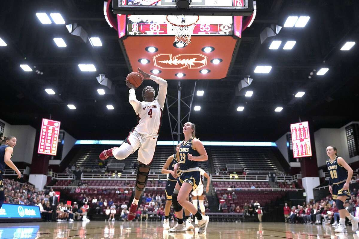 Stanford forward Nadia Fingall (4) shoots over UC Davis forward Kayla Konrad (23) during the second half of an NCAA college basketball game, Saturday, Dec. 28, 2019, in Stanford, Calif. (AP Photo/Tony Avelar)