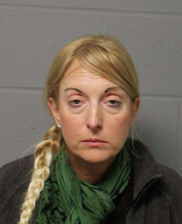 Christine Evans-Bradley, 46, of Norwich, Conn., was charged with second-degree assault with a motor vehicle, driving under the influence and violation of a traffic control signal. Photo: Contributed Photo / North Haven Police Department