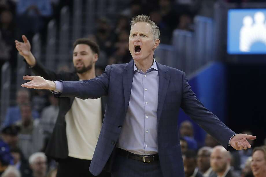 Golden State Warriors head coach Steve Kerr, foreground, and injured guard Klay Thompson react to an official's call during the first half of an NBA basketball game against the Dallas Mavericks in San Francisco, Saturday, Dec. 28, 2019. (AP Photo/Jeff Chiu) Photo: Jeff Chiu / Associated Press