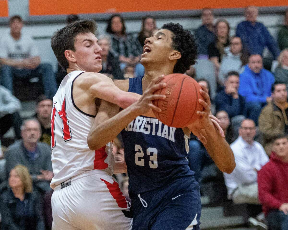 Mekeel Christian junior Alexander Barnhill is fouled by Niskayuna senior Ethan St. Lucia during the finals of the Kirvin Cup at Mohonasen High School on Saturday, Dec. 28, 2019 (Jim Franco/Special to the Times Union.)