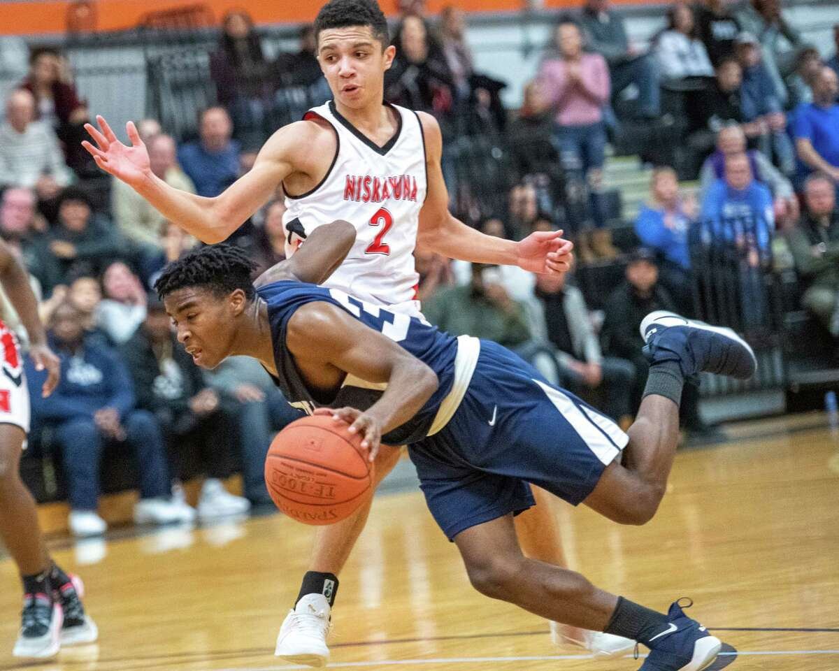 Mekeel Christian point guard Jonon White drives by Niskayuna junior Kenyon Coleman during the finals of the Kirvin Cup at Mohonasen High School on Saturday, Dec. 28, 2019 (Jim Franco/Special to the Times Union.)
