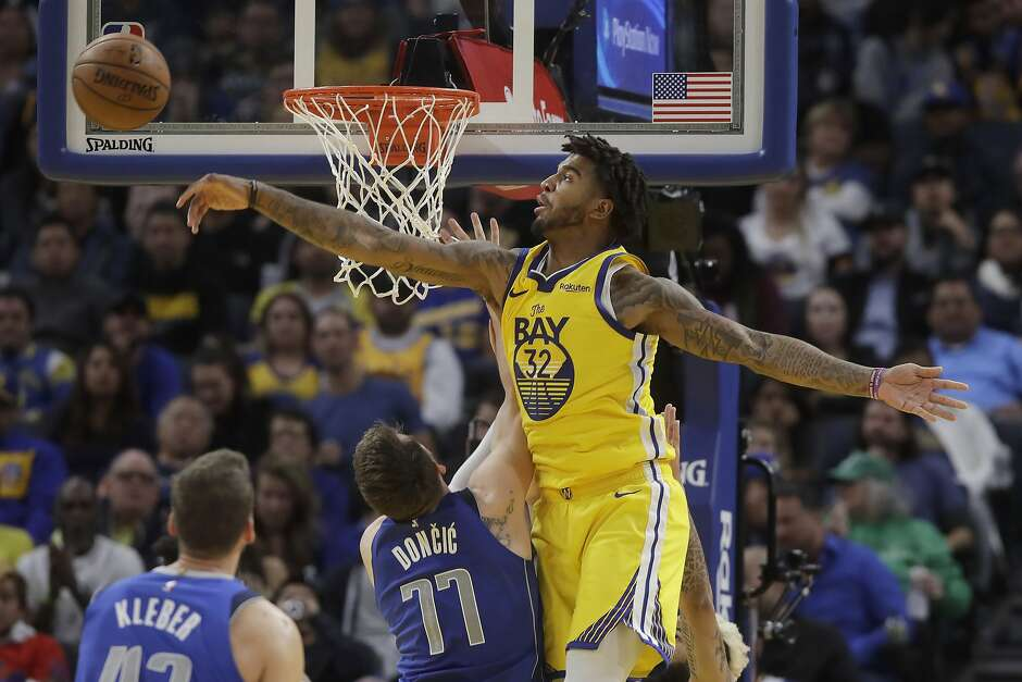 Golden State Warriors forward Marquese Chriss (32) blocks a shot by Dallas Mavericks forward Luka Doncic (77) during the second half of an NBA basketball game in San Francisco, Saturday, Dec. 28, 2019. (AP Photo/Jeff Chiu)