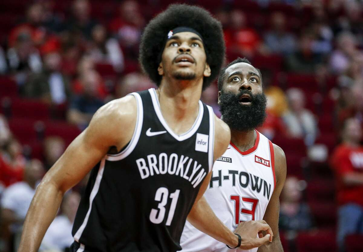 Houston Rockets guard James Harden (13) and Brooklyn Nets center Jarrett Allen (31) watch a free throw during the fourth quarter of an NBA game at the Toyota Center on Saturday, Dec. 28, 2019, in Houston.