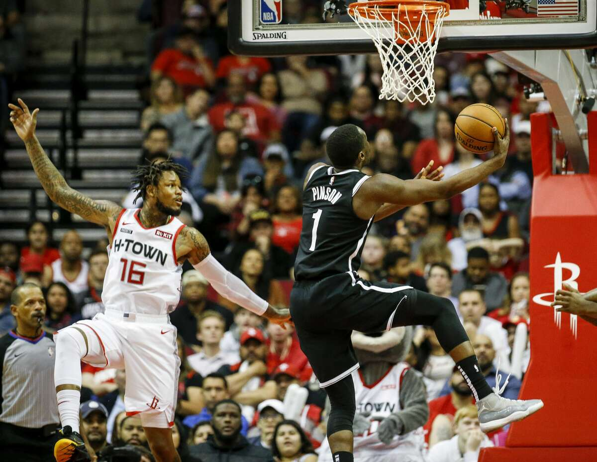 Brooklyn Nets guard Theo Pinson (1) drives to the basket past Houston Rockets guard Ben McLemore (16) during the fourth quarter of an NBA game at the Toyota Center on Saturday, Dec. 28, 2019, in Houston.