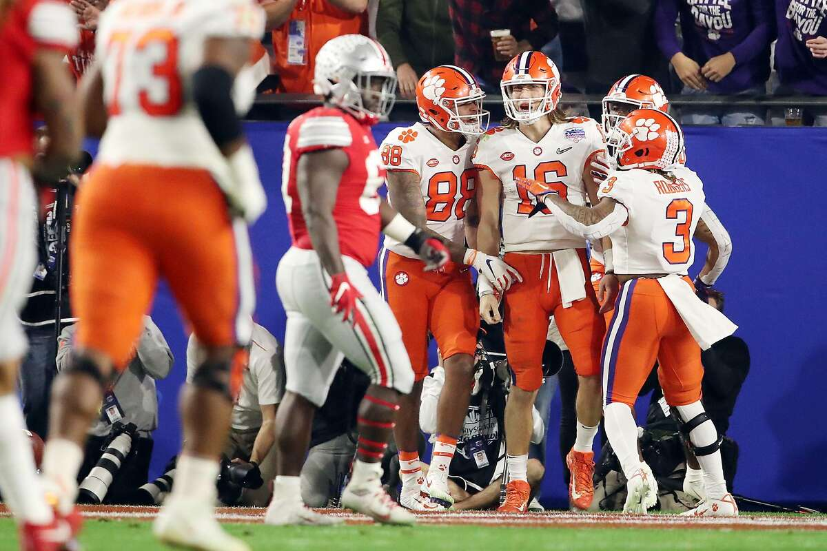 GLENDALE, ARIZONA - DECEMBER 28: Trevor Lawrence #16 of the Clemson Tigers is congratulated by his teammates after his 67-yard touchdown run against the Ohio State Buckeyes during the College Football Playoff Semifinal at the PlayStation Fiesta Bowl at State Farm Stadium on December 28, 2019 in Glendale, Arizona. (Photo by Christian Petersen/Getty Images)