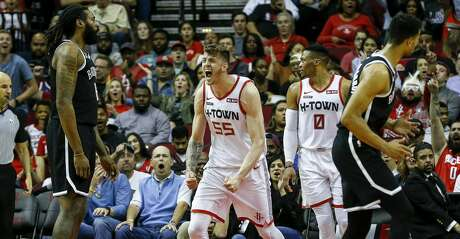 Houston Rockets center Isaiah Hartenstein (55) reacts after scoring during the second quarter of an NBA game at the Toyota Center on Saturday, Dec. 28, 2019, in Houston.