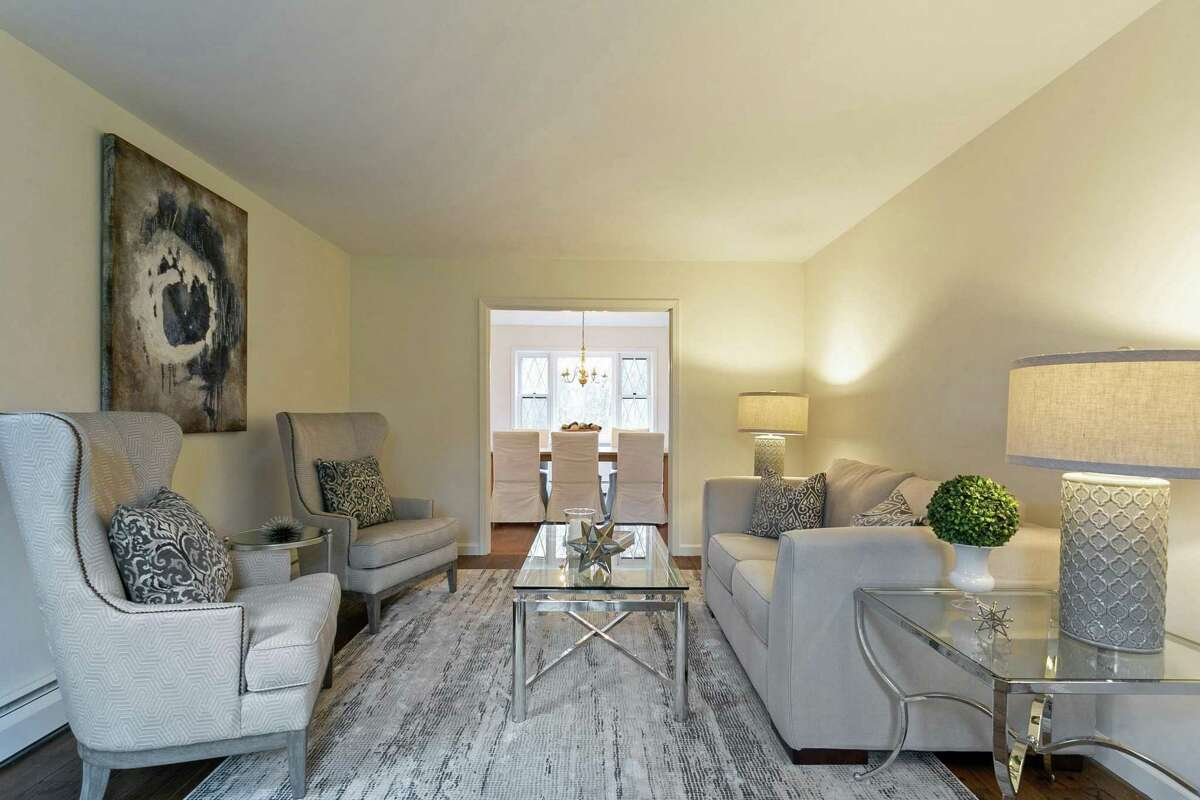 The good-size formal living room accesses the formal dining room.