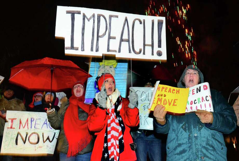 Protester Denise Puffer, of Cape Cod, in center, takes part in a rally with over 200 other area residents to support the impeachment of President Trump along Old Post Road in Fairfield, Conn., on Tuesday Dec. 17, 2019. Photo: Christian Abraham / Hearst Connecticut Media / Connecticut Post