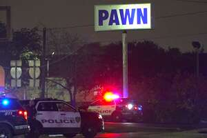 A burglary suspect was arrested after he barricaded himself inside a Houston pawn shop near Federal Road.