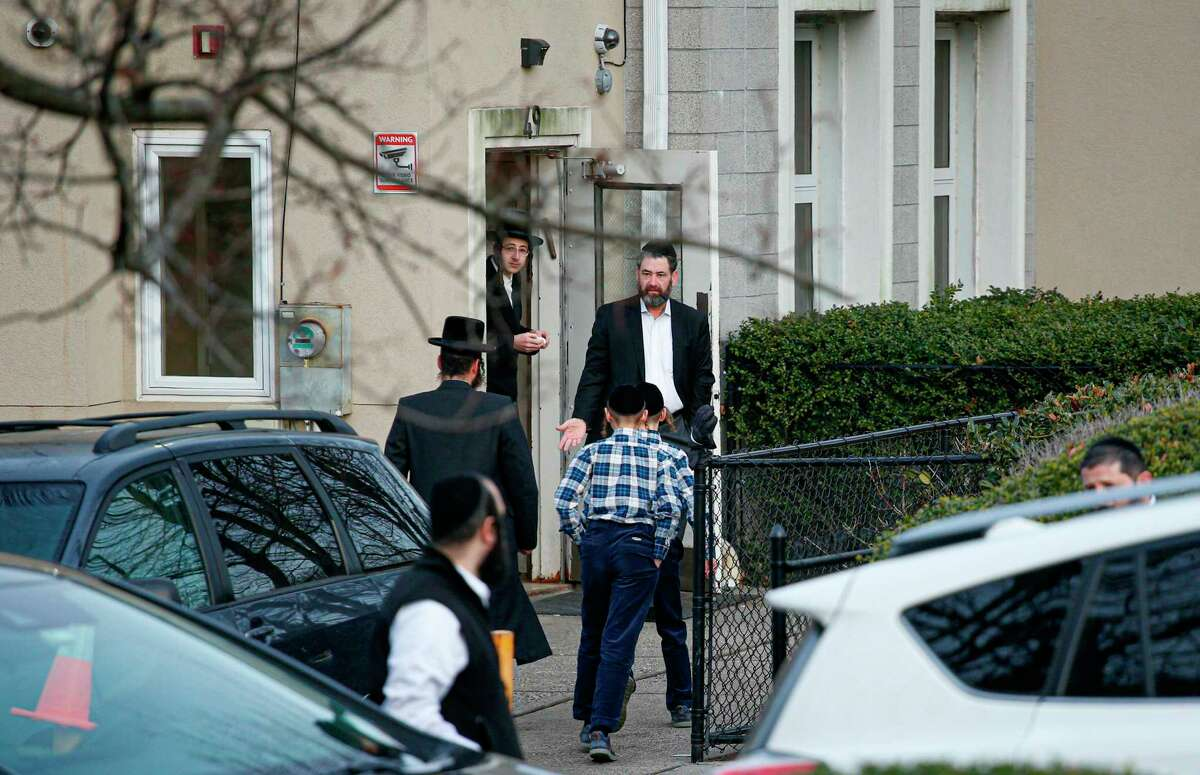 Members of the Jewish community leave from a synagogue next to the home of rabbi, Chaim Rottenberg in Monsey, in New York on December 29, 2019 after a machete attack that took place earlier outside the rabbi's home during the Jewish festival of Hanukkah in Monsey, New York. - An intruder stabbed and wounded five people at a rabbi's house in New York during a gathering to celebrate the Jewish festival of Hanukkah late on December 28, 2019, officials and media reports said. Local police departments, speaking to AFP, declined to give the number of people injured, but a suspect has been taken into custody and a vehicle safeguarded, an NYPD spokesman said. (Photo by Kena Betancur / AFP) (Photo by KENA BETANCUR/AFP via Getty Images)