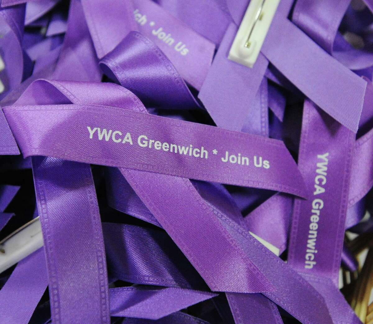 Purple ribbons, part of the domestic violence and abuse prevention initiative, could be seen during the YWCA of Greenwich Domestic Abuse Services annual Candlelight Vigil to honor the victims of domestic violence and abuse at the YWCA of Greenwich, Conn., Tuesday, Oct. 9, 2018. October is Domestic Violence Awareness Month.
