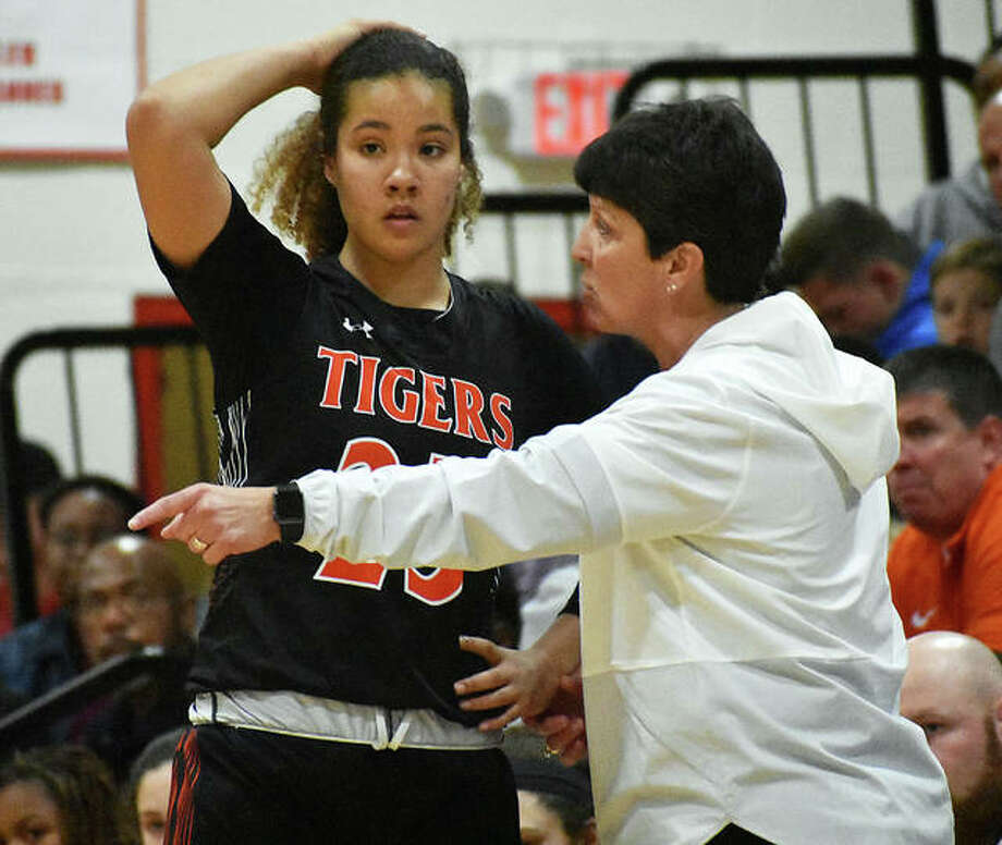 EHS coach Lori Blade gives instructions to forward Sydney Harris during a timeout in the second quarter. Photo: Matt Kamp|The Intelligencer
