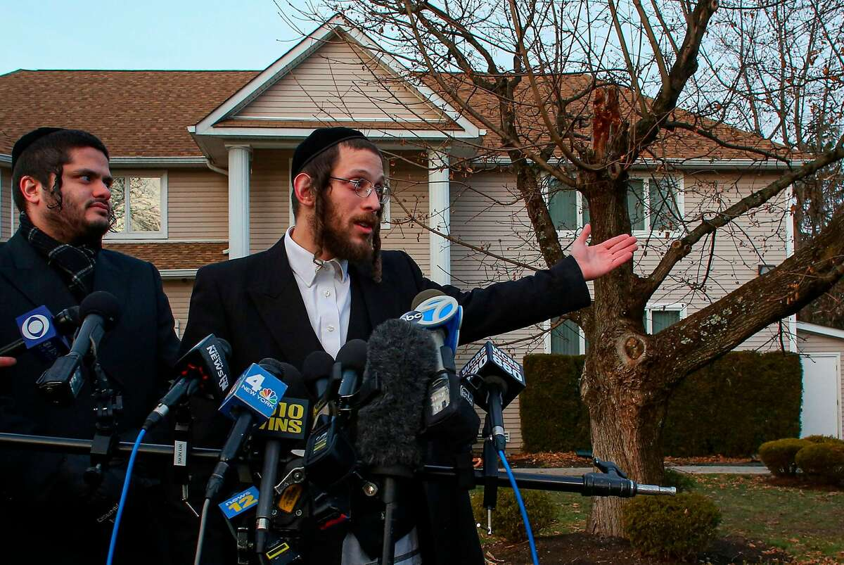 Joseph Gluck (R) talks to the press as he describes the machete attack that took place earlier outside a rabbi's home during the Jewish festival of Hanukkah in Monsey, New York, on December 29, 2019. - An intruder stabbed and wounded five people at a rabbi's house in New York during a gathering to celebrate the Jewish festival of Hanukkah late on December 28, 2019, officials and media reports said. Local police departments, speaking to AFP, declined to give the number of people injured, but a suspect has been taken into custody and a vehicle safeguarded, an NYPD spokesman said. (Photo by Kena Betancur / AFP) (Photo by KENA BETANCUR/AFP via Getty Images)