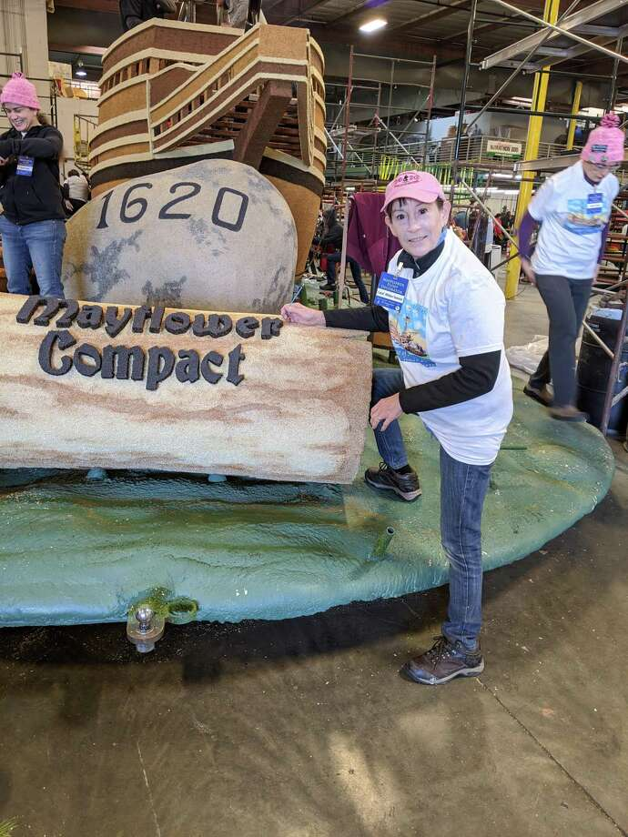 Darien's Carol Wilder-Tamme is hard at work in Pasadena on the Mayflower float for the Tournament of Roses Parade. Wilder Tamme, who had ancestors on the Mayflower, was selected to ride on the float after submitting an eight page application. Photo: Courtesy Carol Wilder Tamme