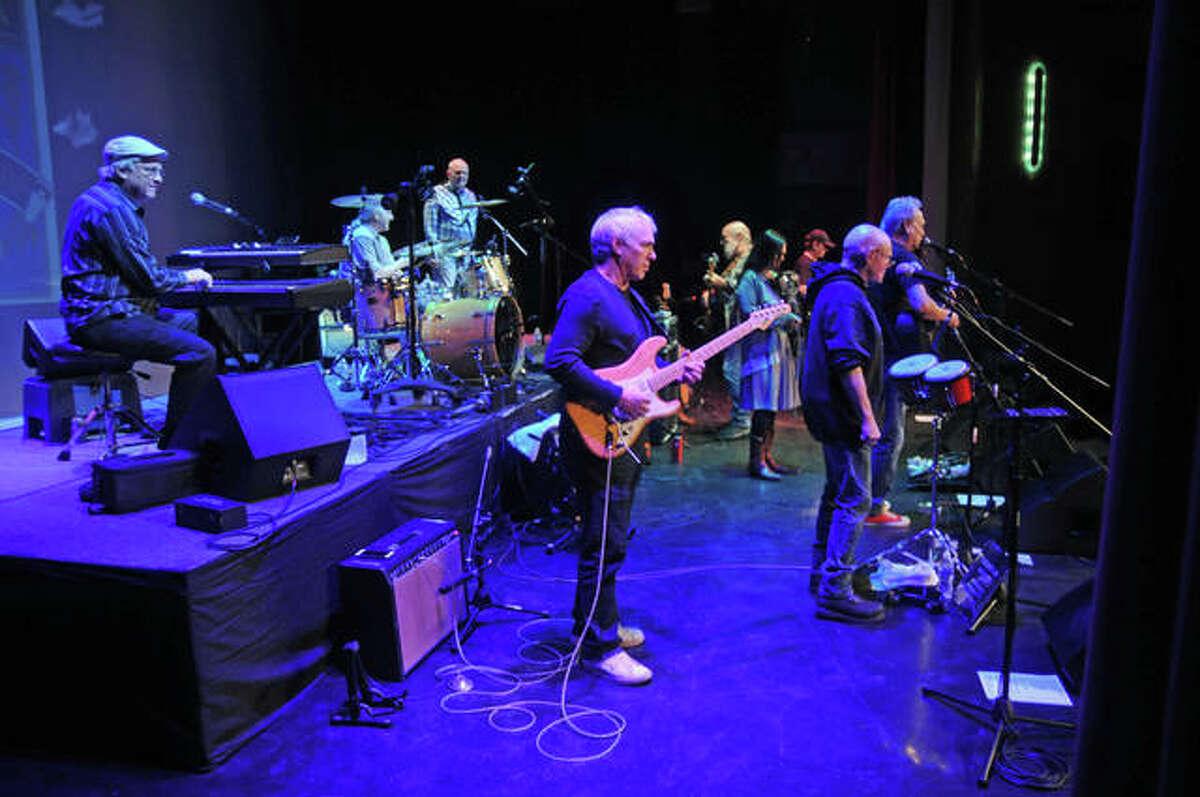 FILE - The Ozark Mountain Daredevils take their places on stage.
