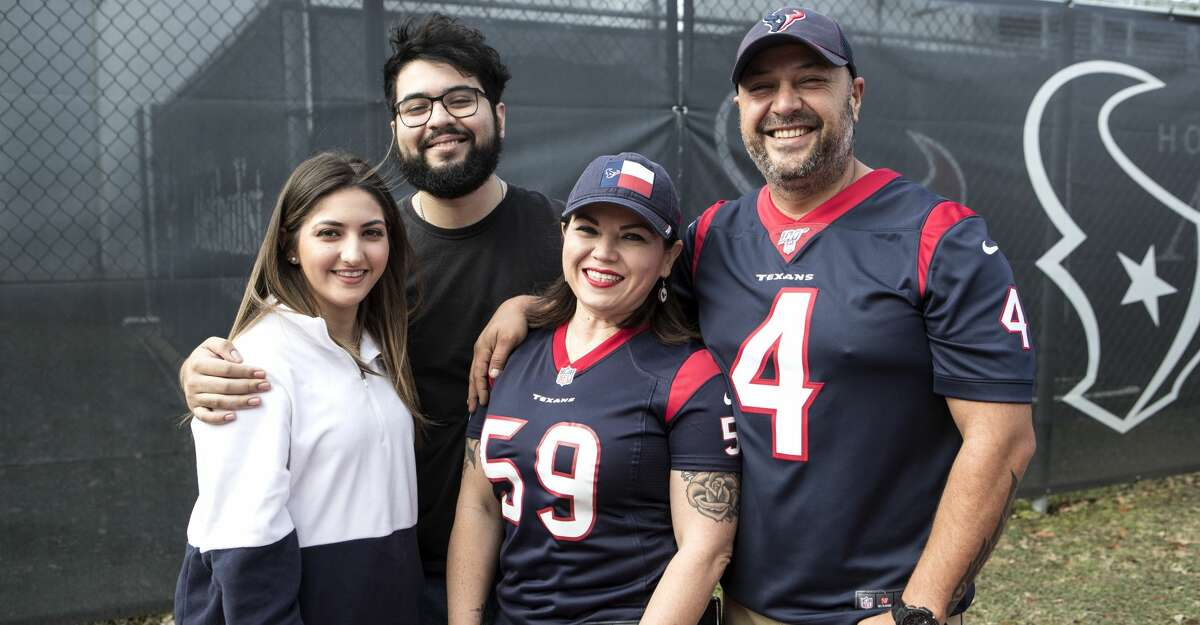 Houston Texans line up for a pre-game tailgate party at the Houston Methodist Training Center bubble before the Texans game against the Tennessee Titans on Sunday, Dec. 29, 2019, in Houston.