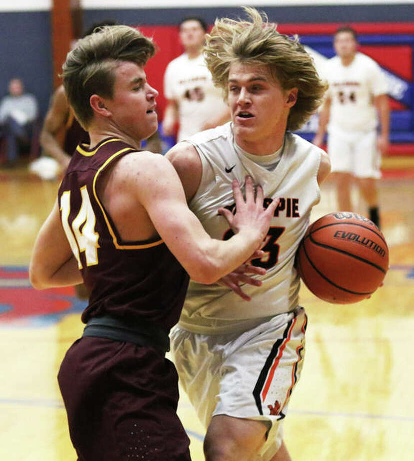 Gillespie's Frankie Barrett (right) is fouled by EA-WR's Spencer Slayden on his way to the basket in a pool game Thursday at the Carlinville Holiday Tourney. Barrett scored 15 points Saturday, but the Miners fell to Staunton and will play for third place in the tourney Monday against Hillsboro. Photo: Greg Shashack / The Telegraph