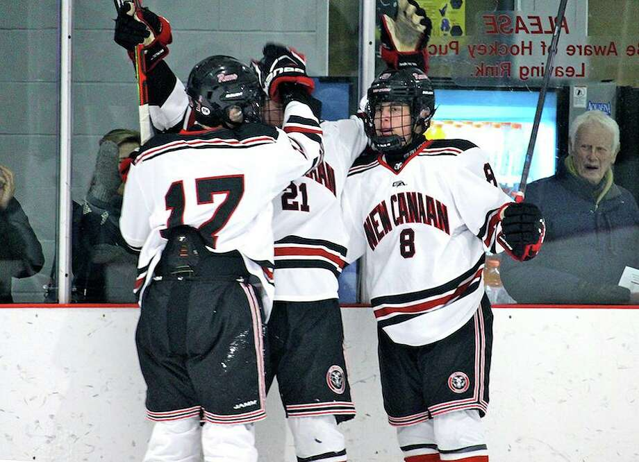 New Canaan's Justin Wietfeldt (17), Carter Ellis (21) and Griffin Deane (8) celebrate a goal by Ellis during the Rams' 4-2 win over Immaculate at the Darien Ice House on Saturday, Dec. 28, 2019. Photo: Terry Dinan / For Hearst Connecticut Media / For Hearst Connecticut Media