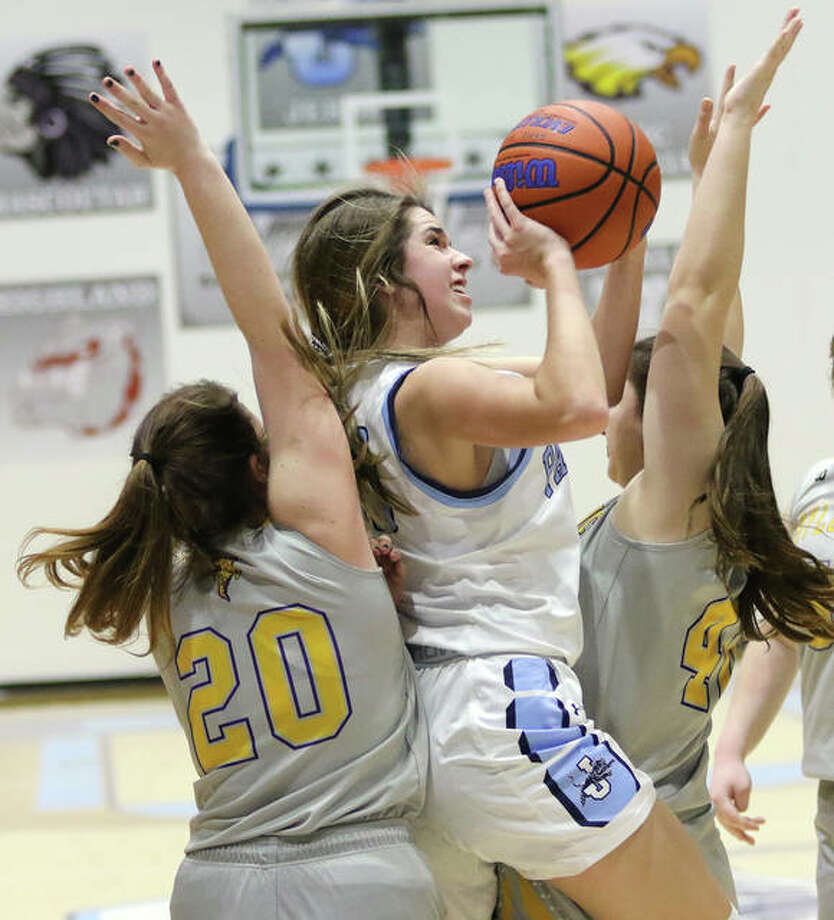 Jersey's Abby Manns manages to score in tight quarters between Taylorvill'es Kristina Allen and Meghan Donnan during a Panthers' win Friday in the Deck the Halls with Basketballs Tourney at Havens Gym in Jerseyville. The Panthers will play Marquette for the tourney title on Monday night. Photo: Greg Shashack / The Telegraph