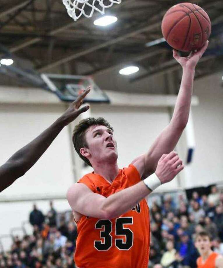 Matt DeLuca and the Ridgefield boys basketball team split two games to finish third in a holiday tournament in Bridgeport. Photo: Erik Trautmann / Hearst Connecticut Media
