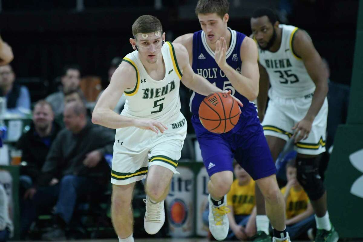 Siena's Matt Hein brings the ball up the court during their game against Holy Cross at the Times Union Center on Sunday, Dec. 29, 2019, in Albany, N.Y. (Paul Buckowski/Times Union)