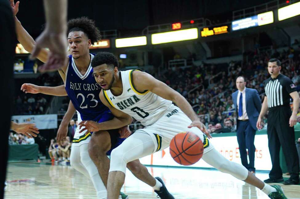 Siena's Donald Carey drives along the baseline during their game against Holy Cross at the Times Union Center on Sunday, Dec. 29, 2019, in Albany, N.Y. (Paul Buckowski/Times Union)