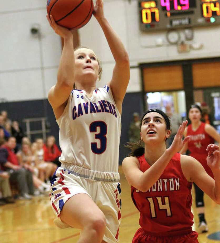 Carlinville's Eryn Seals (3) goes in for a layup ahead of Staunton's Katie Masinelli on a break Thursday at the Carlinville Holiday Tourney. Photo: Greg Shashack / The Telegraph