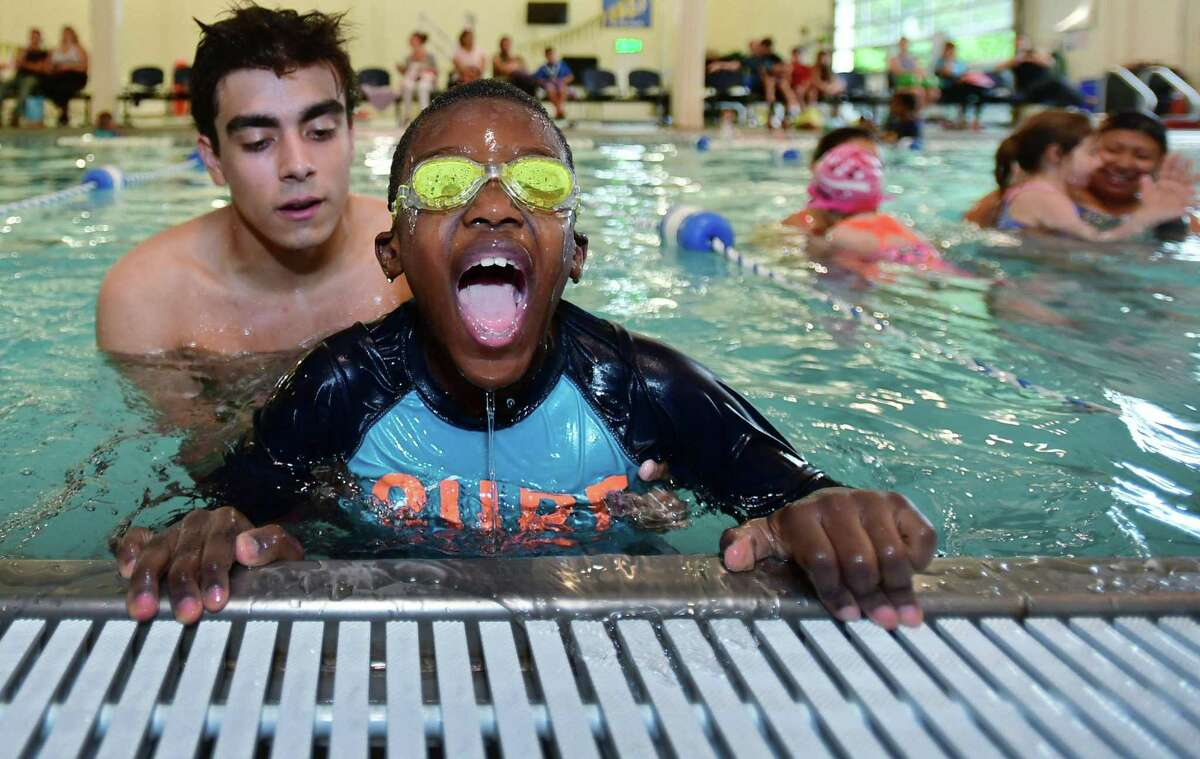 Norwalk Recreation & Parks swim instructor Mateo Roldan helps Zuhayr Estime, 6, return to the pool edge Thursday, June 20, 2019, as the City of Norwalk Recreation & Parks Department and Velo-CT team up for World's Largest Swimming Lesson (WLSL) at the Velo facility in Norwalk, Conn. The global event celebrates its 10th anniversary with events taking place over 24 hours at an estimated 600 locations in more than 20 countries.