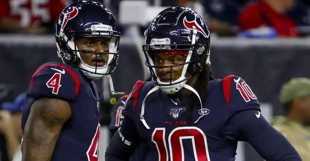Houston Texans quarterback Deshaun Watson (4) and wide receiver DeAndre Hopkins (10) warm up before an NFL football game at NRG Stadium on Thursday, Nov. 21, 2019, in Houston.