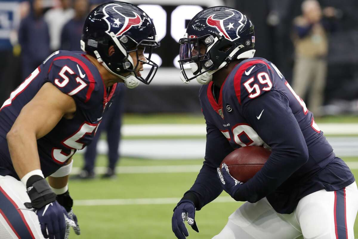 Whitney Mercilus, right, is the only legitimate pass rusher among the Texans linebackers.