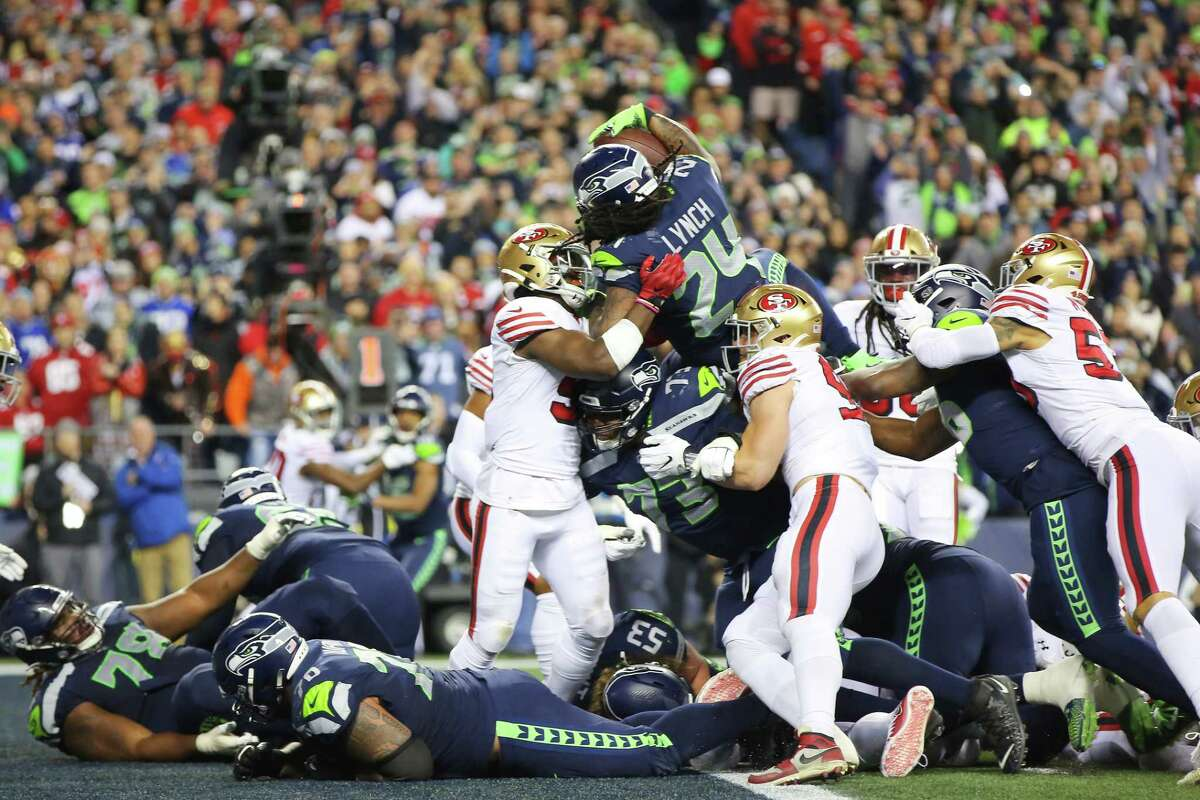 Seattle Seahawks running back Marshawn Lynch (24) dives for a one yard touchdown in the fourth quarter of Seattle's game against San Francisco, Sunday, Dec. 29, 2019 at CenturyLink Field.