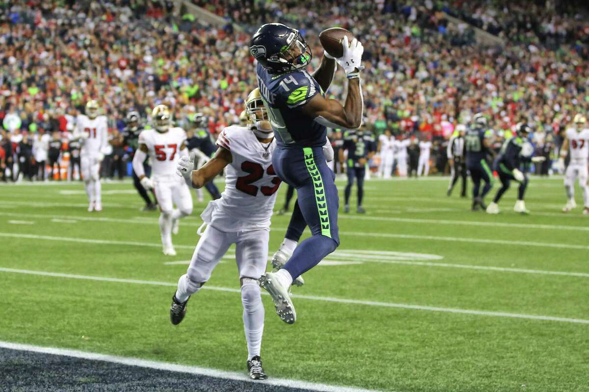Seattle Seahawks wide receiver D.K. Metcalf (14) catches a 14-yard touchdown pass ahead of San Francisco 49ers cornerback Ahkello Witherspoon (23) in the fourth quarter of Seattle's game against San Francisco, Sunday, Dec. 29, 2019 at CenturyLink Field.