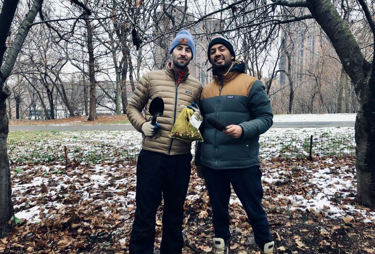 Jared Fox, left, and teacher Erick Espin during cleanup efforts at Highbridge Park in upper Manhattan. When the Times Square Alliance made combating climate change and youth-led environmental activism the theme of the big bash at Times Square, Fox was contacted about being a part of the ball drop on New Year's Eve. (Provided)