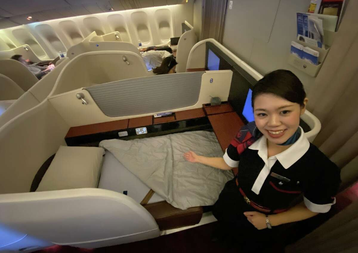 Japan Airlines flight attendants offered to make up the unoccupied seat across the aisle from me for sleeping on JAL Flight #1, SFO to Tokyo Haneda.