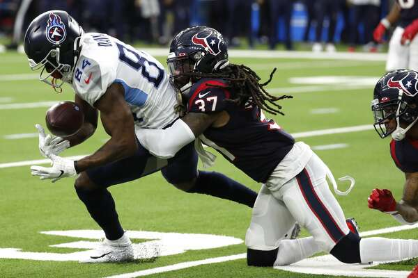 Tennessee Titans wide receiver Corey Davis (84) makes a catch with Houston Texans strong safety Jahleel Addae (37) defending during the second quarter of an NFL football game at NRG Stadium on Sunday, Dec. 29, 2019, in Houston.