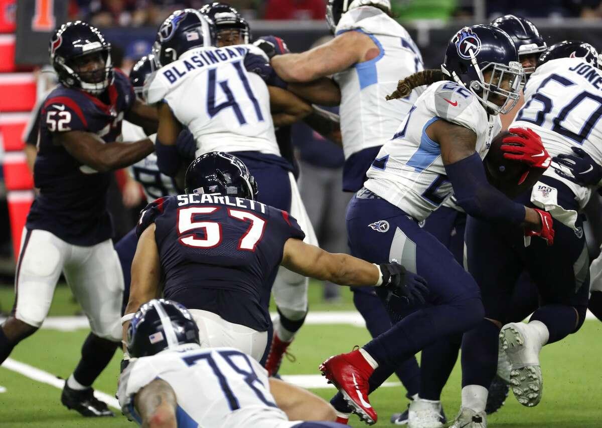 Tennessee Titans running back Derrick Henry (22) runs past Houston Texans outside linebacker Brennan Scarlett (57) during the fourth quarter of an NFL football game at NRG Stadium on Sunday, Dec. 29, 2019, in Houston.