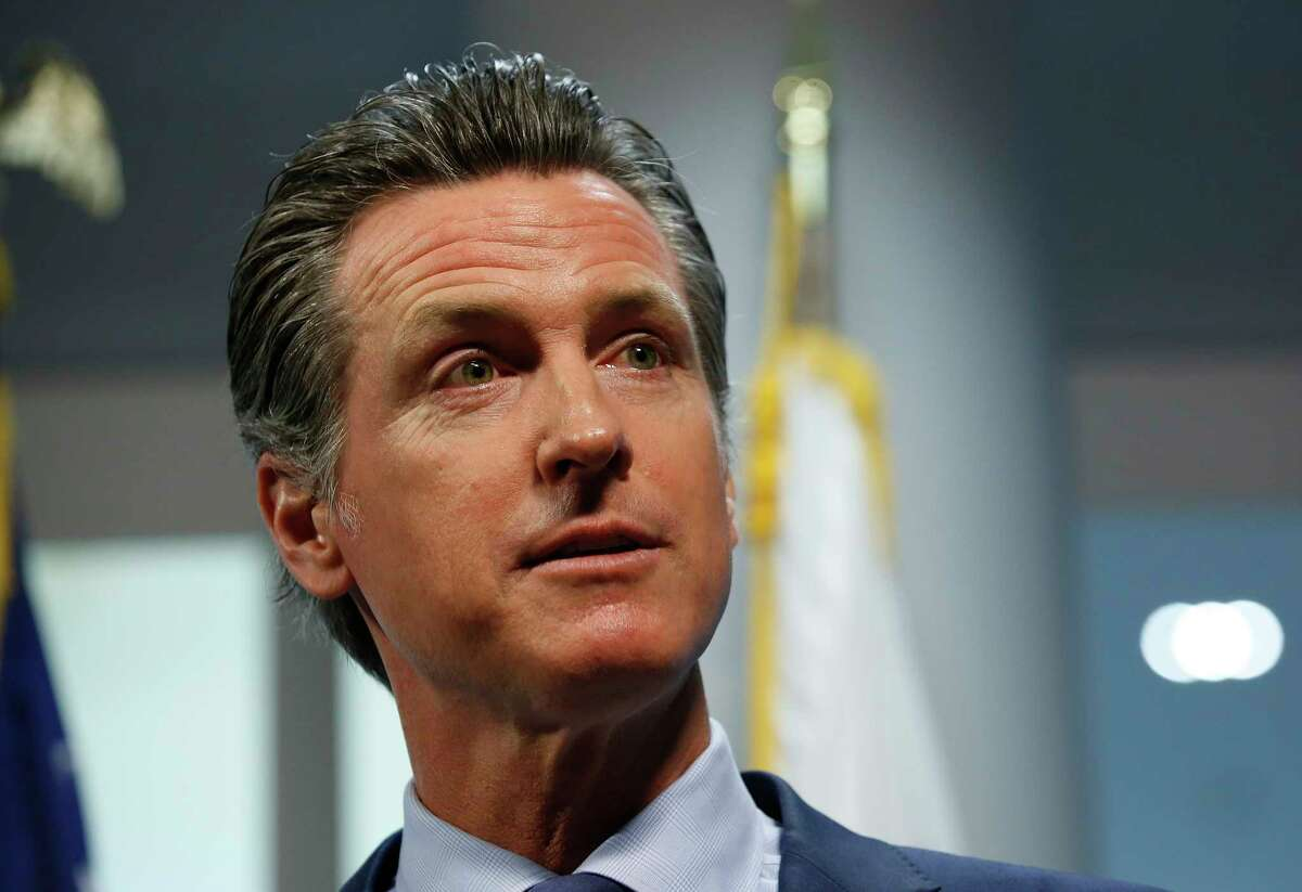 FILE - In this April 12, 2019, file photo, California Gov. Gavin Newsom answers a reporter's question about a report he presented concerning the worsening wildfires in the state, during a news conference, in Rancho Cordova, Calif.