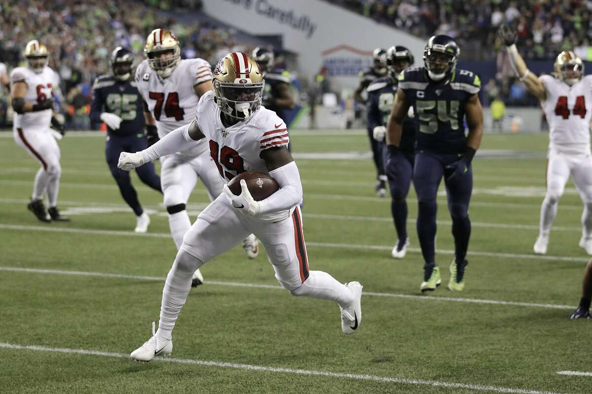 San Francisco 49ers wide receiver Deebo Samuel scores on a 30-yard run against the Seattle Seahawks during the first half of an NFL football game, Sunday, Dec. 29, 2019, in Seattle. (AP Photo/Stephen Brashear)