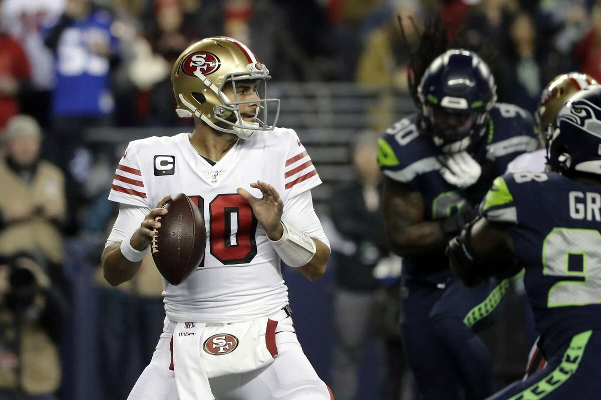 San Francisco 49ers quarterback Jimmy Garoppolo drops back to pass against the Seattle Seahawks during the first half of an NFL football game, Sunday, Dec. 29, 2019, in Seattle.