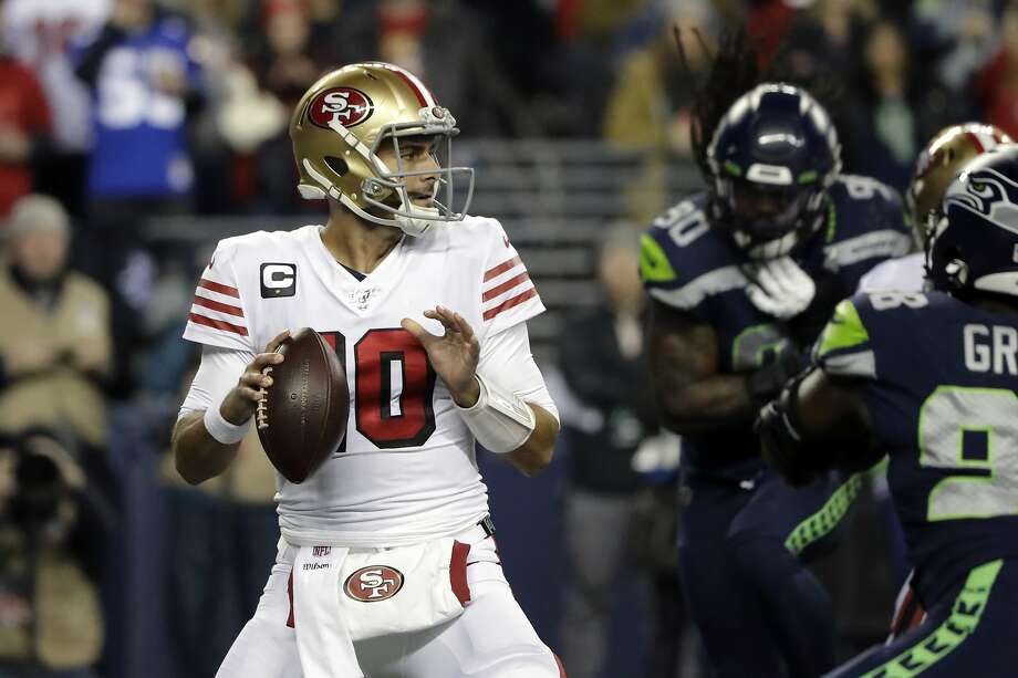 San Francisco 49ers quarterback Jimmy Garoppolo drops back to pass against the Seattle Seahawks during the first half of an NFL football game, Sunday, Dec. 29, 2019, in Seattle. Photo: Ted S. Warren / Associated Press