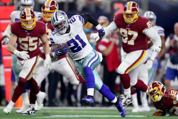 ARLINGTON, TEXAS - DECEMBER 29: Ezekiel Elliott #21 of the Dallas Cowboys carries the ball against the Washington Redskins in the second quarter at AT&T Stadium on December 29, 2019 in Arlington, Texas. (Photo by Tom Pennington/Getty Images)