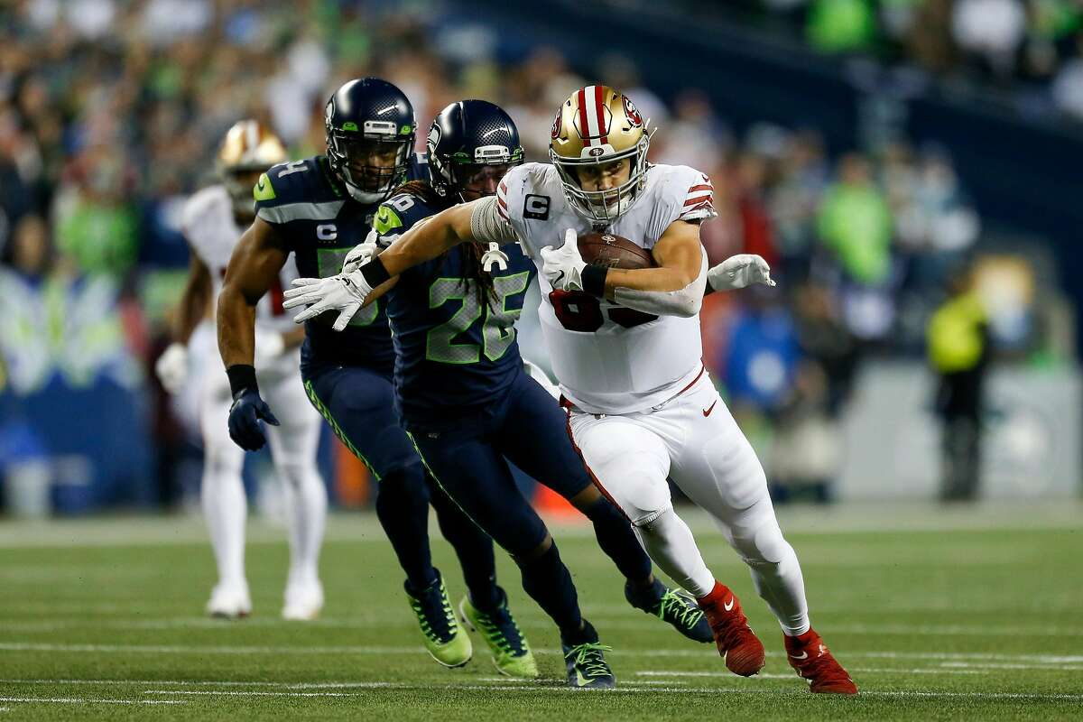 SEATTLE, WASHINGTON - DECEMBER 29: Tight end George Kittle #85 of the San Francisco 49ers runs the ball against cornerback Shaquill Griffin #26 of the Seattle Seahawks during the first half of the game at CenturyLink Field on December 29, 2019 in Seattle, Washington. (Photo by Otto Greule Jr/Getty Images)