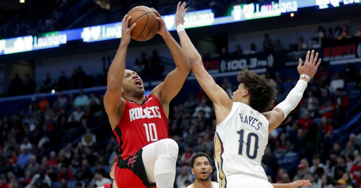 Houston Rockets guard Eric Gordon (10) drives to the basket against New Orleans Pelicans center Jaxson Hayes (10) in the first half of an NBA basketball game in New Orleans, Sunday, Dec. 29, 2019. (AP Photo/Gerald Herbert)