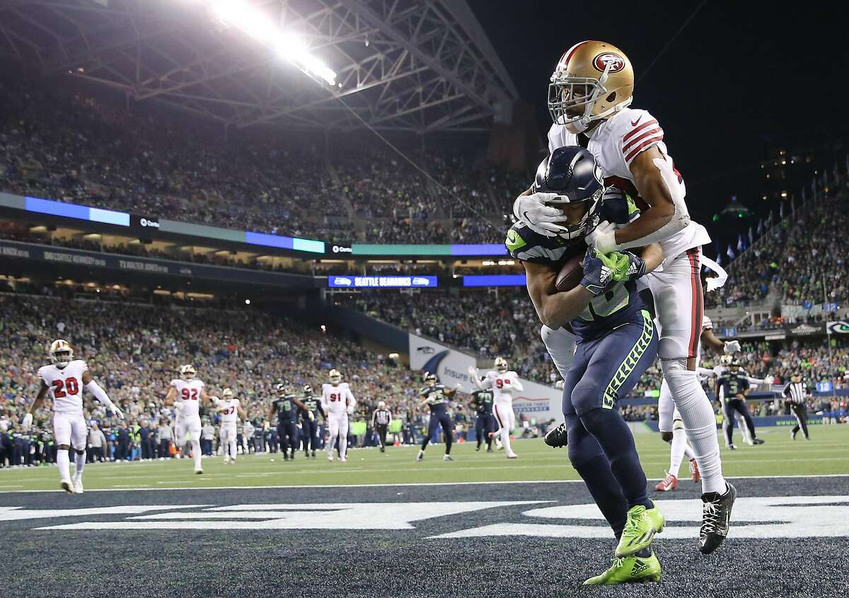 Wide receiver Tyler Lockett #16 of the Seattle Seahawks makes a touchdown catch against cornerback Ahkello Witherspoon #23 of the San Francisco 49ers during the third quarter of the game at CenturyLink Field on December 29, 2019 in Seattle, Washington.