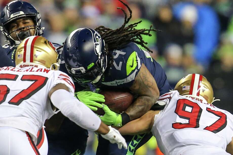 Marshawn Lynch plows into San Francisco 49ers during a game, Dec. 29, 2019. Photo: Genna Martin, Seattlepi.com / SEATTLEPI